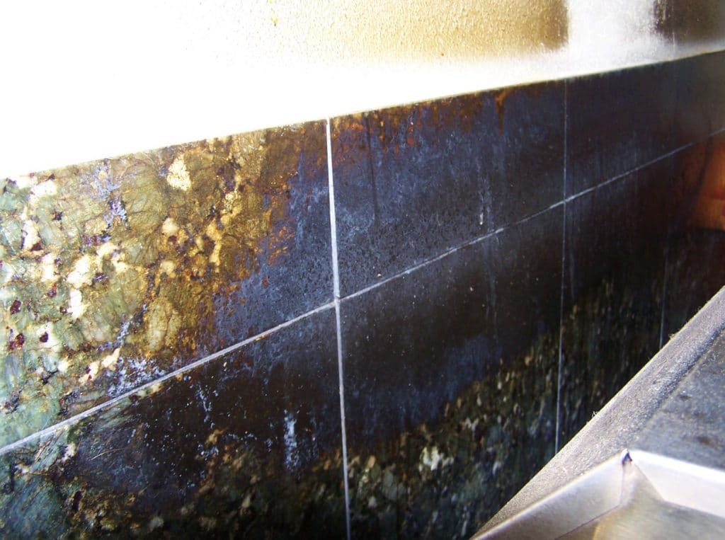 granite backsplash caked with years of grease soot